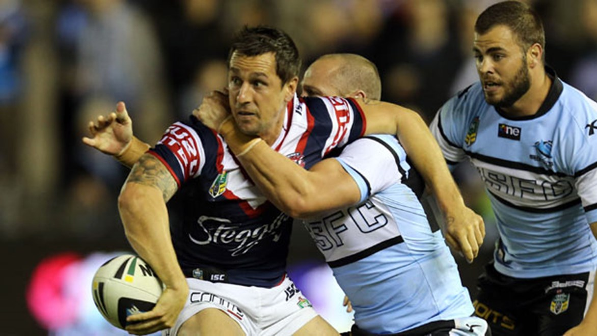 Mitchell Pearce gets the ball away against Cronulla.
