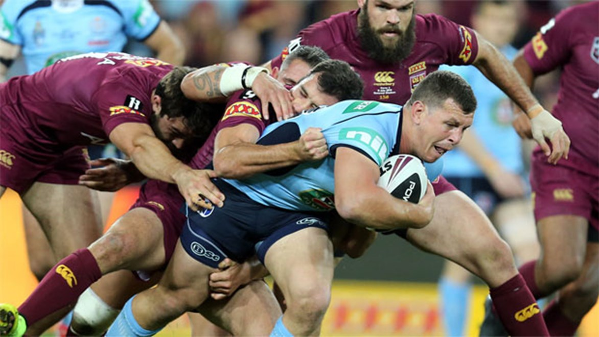 Greg Bird is dragged to ground by the Queensland defence during Origin III.
