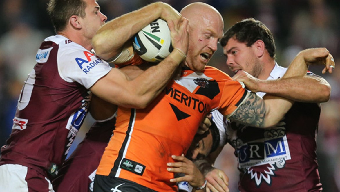 Keith Galloway charges forward for the Wests Tigers during their Round 18 clash with the Sea Eagles.