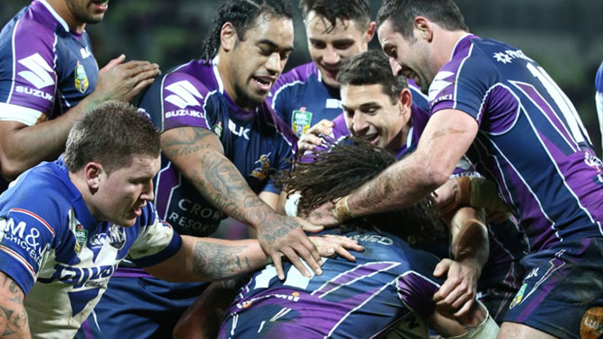 Melbourne Storm players celebrate their first-half try on Saturday night.
