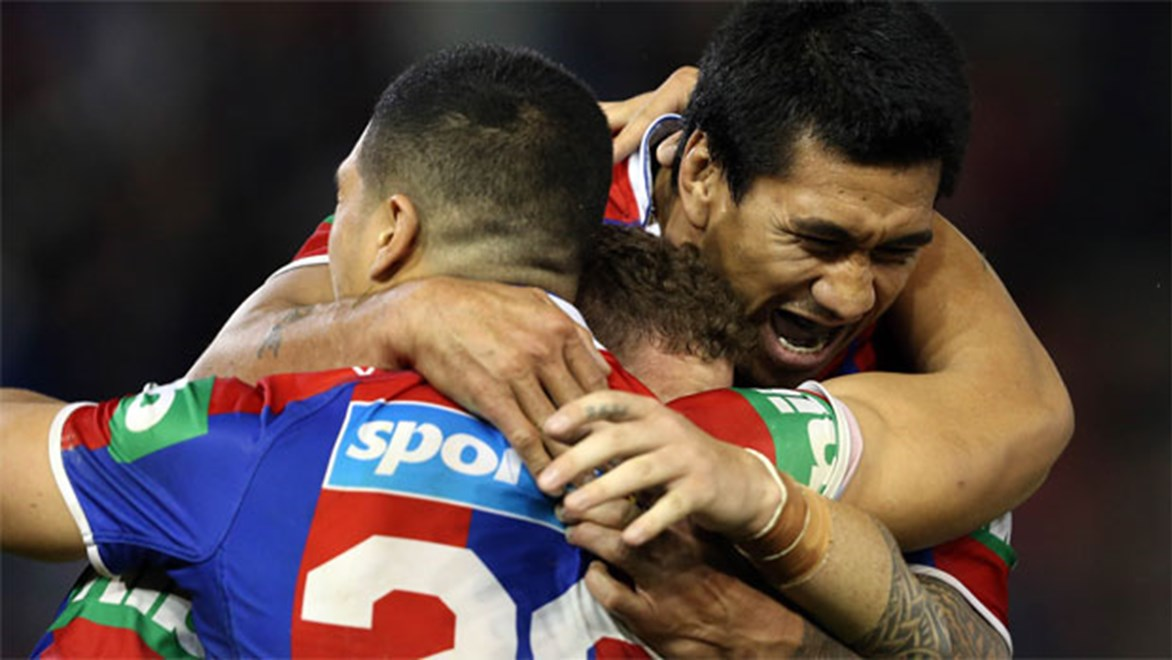 The Newcastle Knights celebrate their shock win over the Roosters on Friday night.