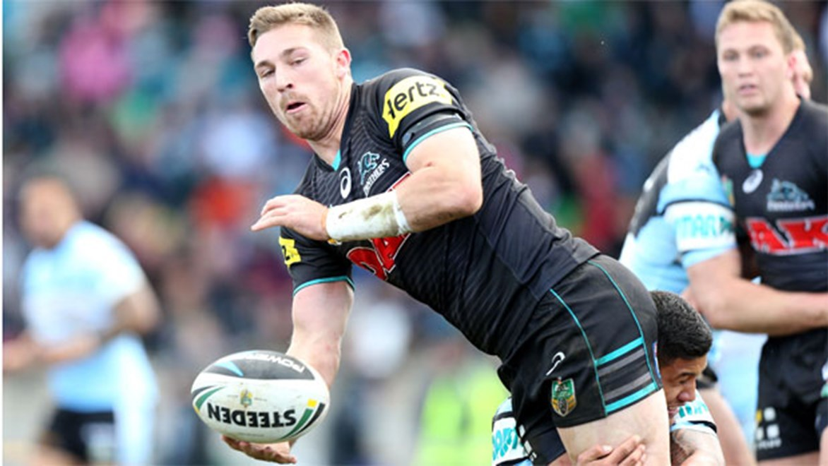 Panthers second rower Bryce Cartwright offloads against Cronulla at Bathurst in Round 20.