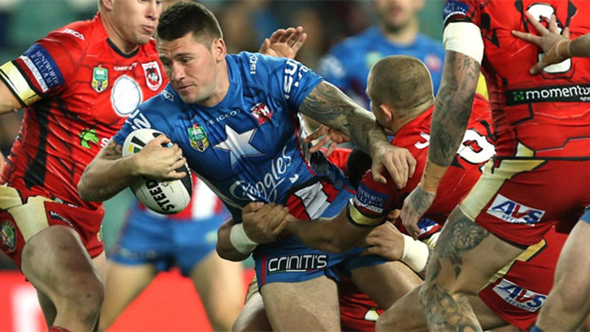 Shaun Kenny-Dowall takes on the defence in the Roosters' superhero-themed clash with the Dragons on Saturday night.