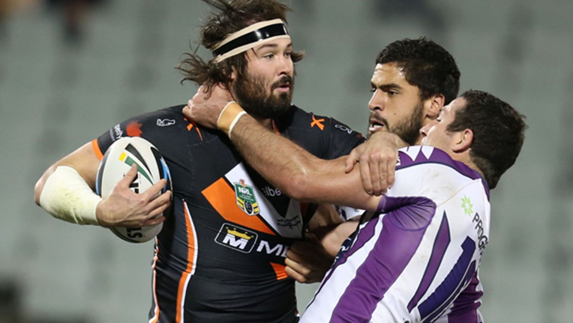 Aaron Woods in action for the Tigers against the Storm at Campbelltown Stadium in Round 21.