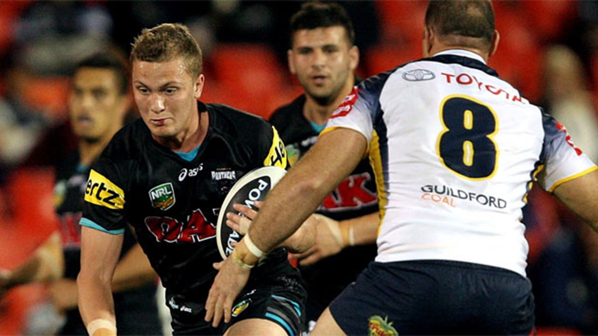 Panthers fullback Matt Moylan tries to find a way past Cowboys prop Matt Scott at Penrith last year.