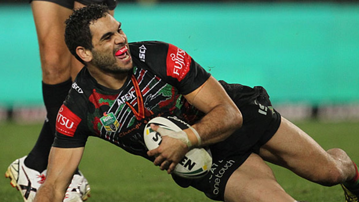 South Sydney fullback Greg Inglis celebrates one of his three tries after dismantling the Broncos on Friday night