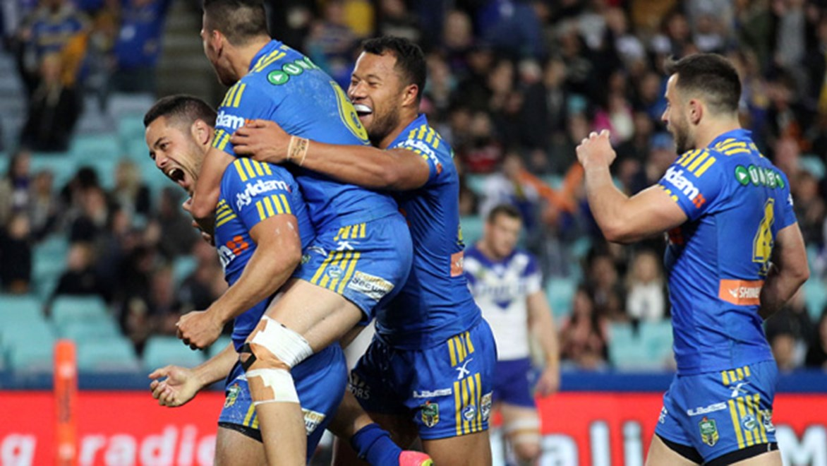 Jarryd Hayne celebrates with his Parramatta teammates during their Round 23 clash with the Bulldogs.