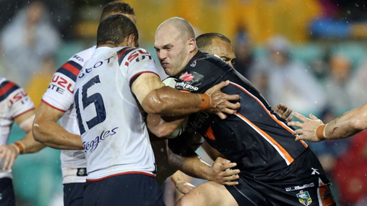 Wests Tigers forward Cory Paterson runs into the Roosters wall of defence in his side's 48-4 loss on Saturday night.