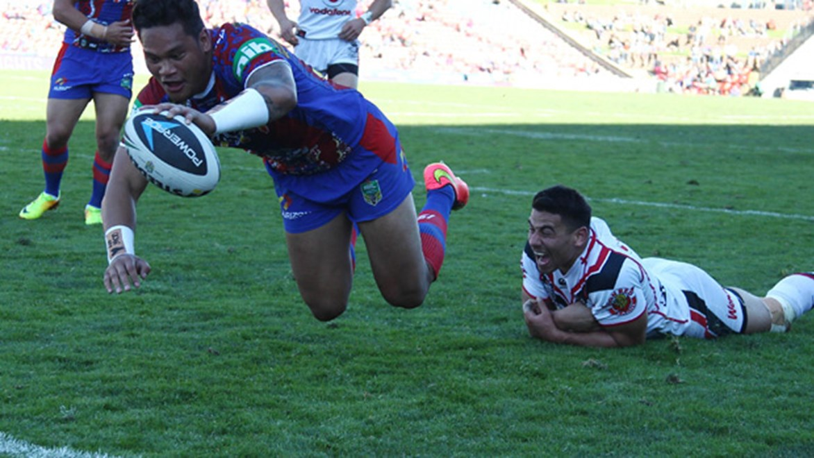 Joey Leilua dives over to score during the Knights' Round 23 meeting with the Warriors at Hunter Stadium.