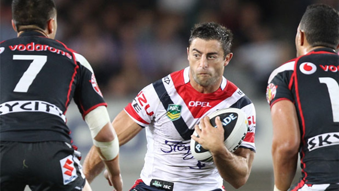 Roosters captain Anthony Minichiello looks to evade Warriors halfback Shaun Johnson at Eden Park last year.