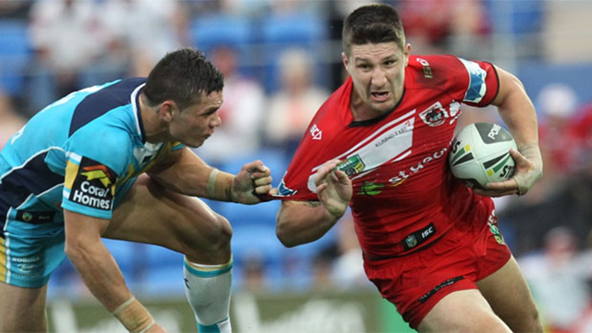 Dragons five-eighth Gareth Widdop runs past Titans centre James Roberts at CBus Super Stadium in Round 15.