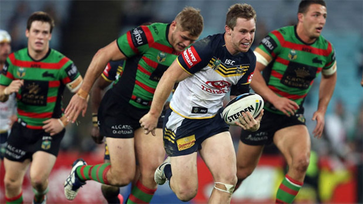 Michael Morgan makes a line break against the Rabbitohs on Saturday night.