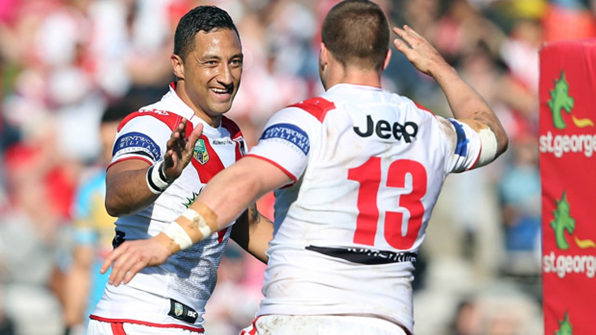 Benji Marshall celebrates with Trent Merrin during the Dragons' Round 24 win over the Titans.