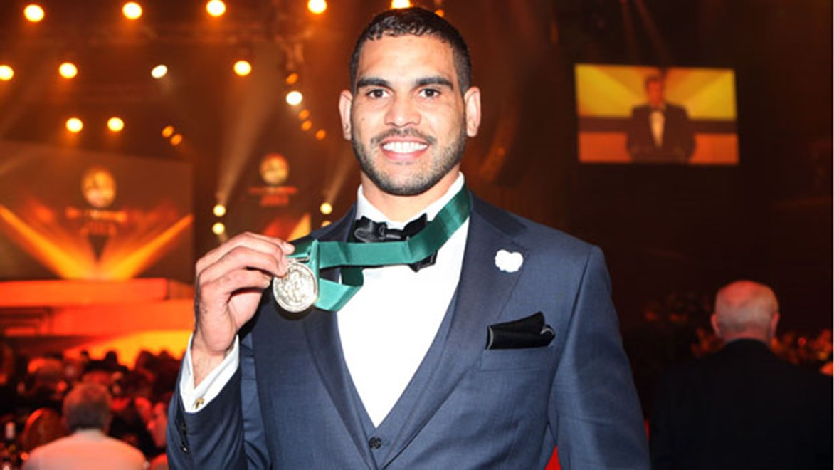 Greg Inglis proudly shows off the Provan-Summons Medal he won in 2014 after fans voted him the best player in the NRL in 2013.