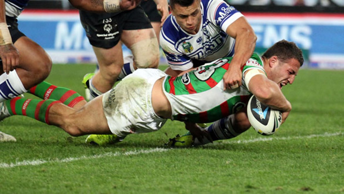 Sam Burgess crosses for one of his two tries of the evening in the Rabbitohs 21-14 win over the Bulldogs.