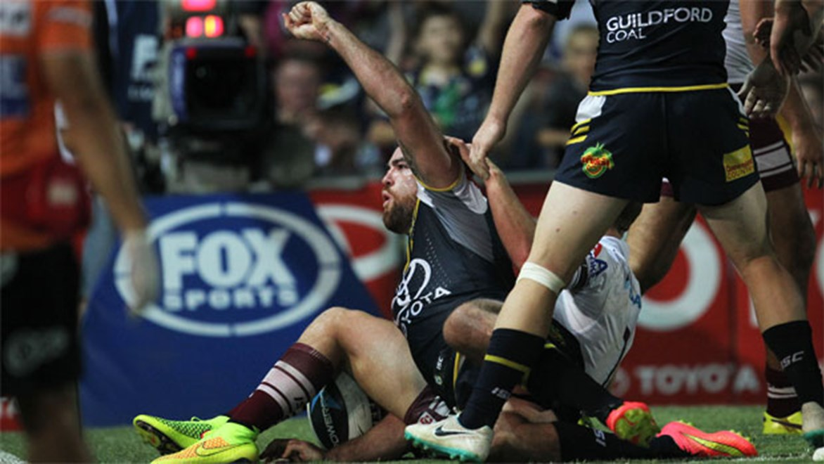Kane Linnett celebrates his first-half try against Manly on Saturday night.