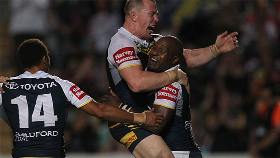 Robert Lui celebrates a try to the Cowboys with Glenn Hall during their 30-16 win over Manly in Round 26.