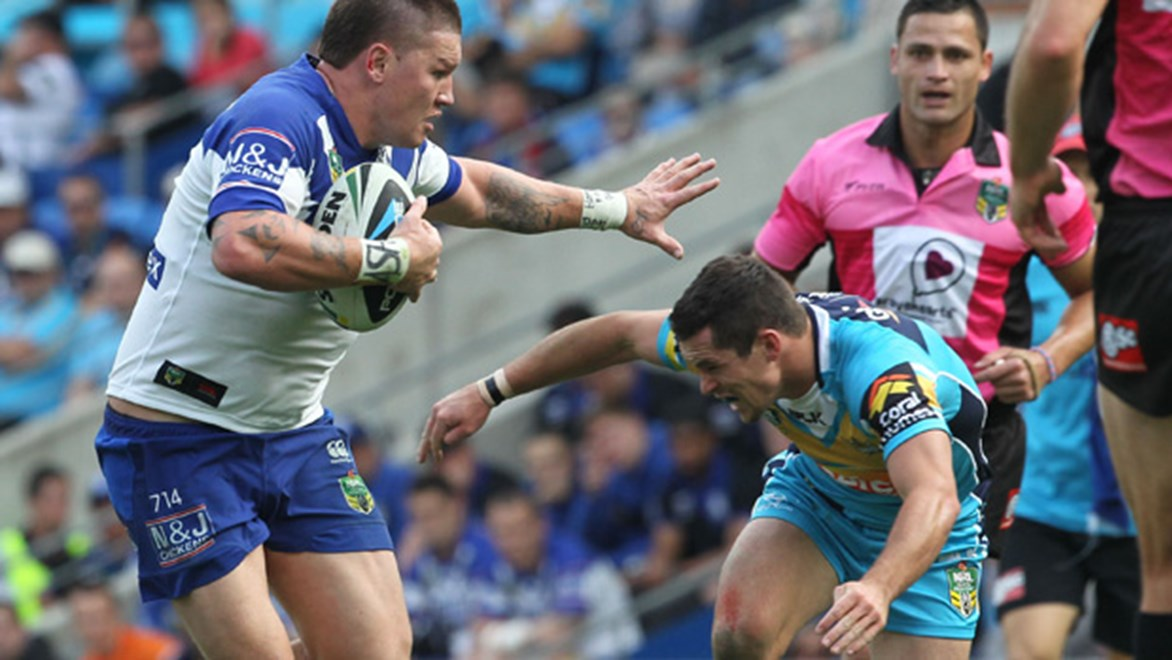 Greg Eastwood charges forward in the Bulldogs' Round 26 clash with the Titans.