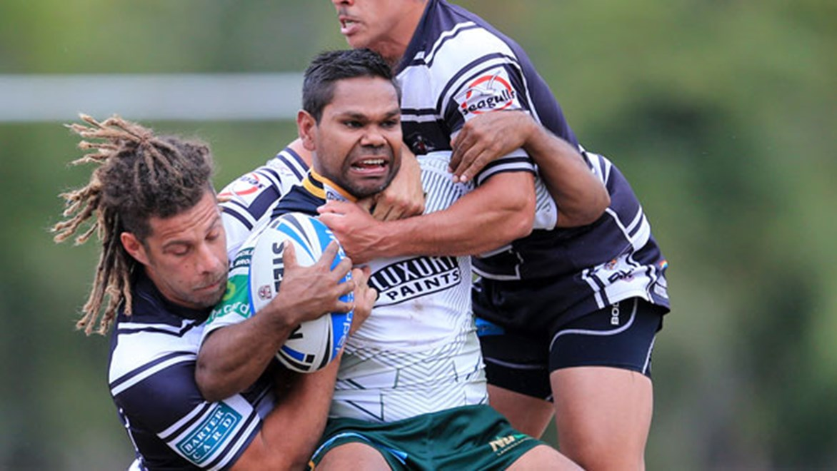 Ipswich's Brandon Marshall is subdued by the Tweed Heads defence but it was the Jets who emerged victorious.