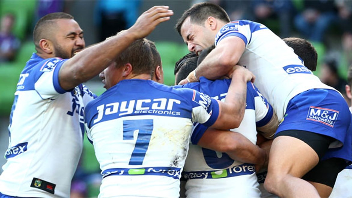 The Bulldogs celebrate one of four first half tries in their elimination final win over the Storm in Melbourne.