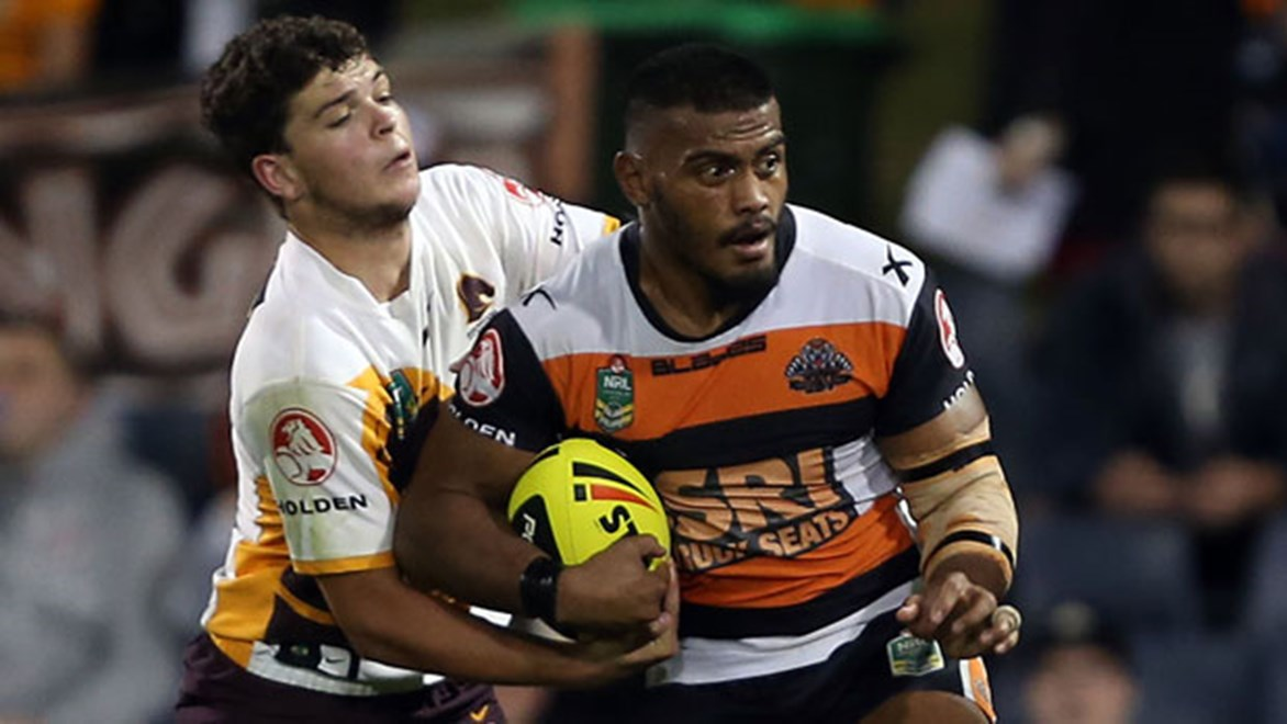 Broncos half Ashley Taylor grapples with Wests Tigers forward Salesi Funaki when the two teams met in the Holden Cup earlier this season.
