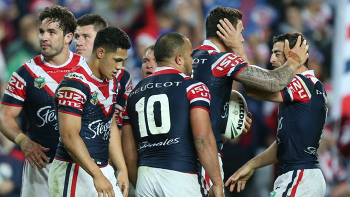 Roosters celebrate their one-point win over the Cowboys to book a preliminary final date with the Rabbitohs.