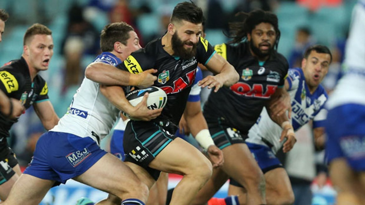 Josh Mansour makes a break against the Bulldogs.
