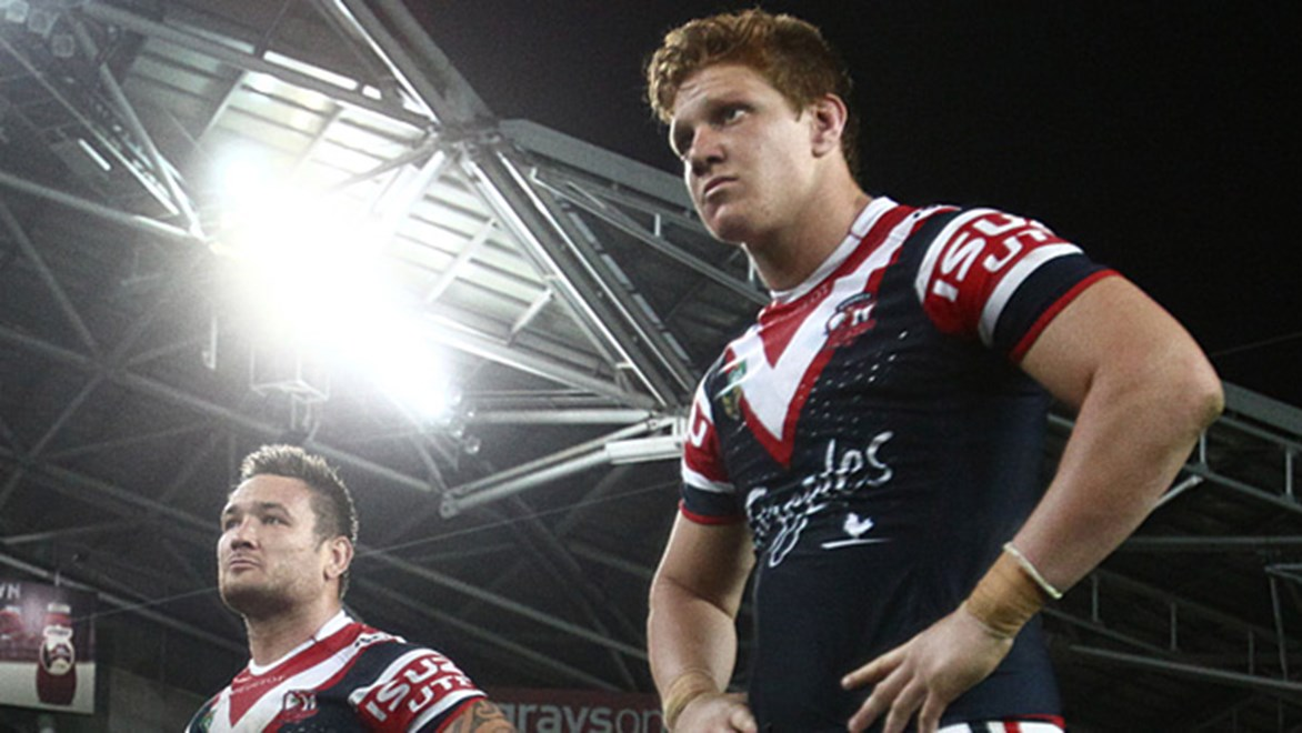 Roosters players stand dejected following their preliminary final loss to the Rabbitohs.