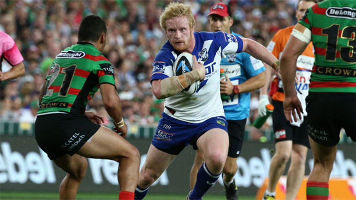 Stand-in Bulldogs skipper James Graham takes on the Rabbitohs defence on Sunday night.