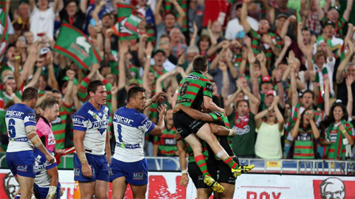 South Sydney fans celebrate their team's opening try against the Bulldogs on Sunday.
