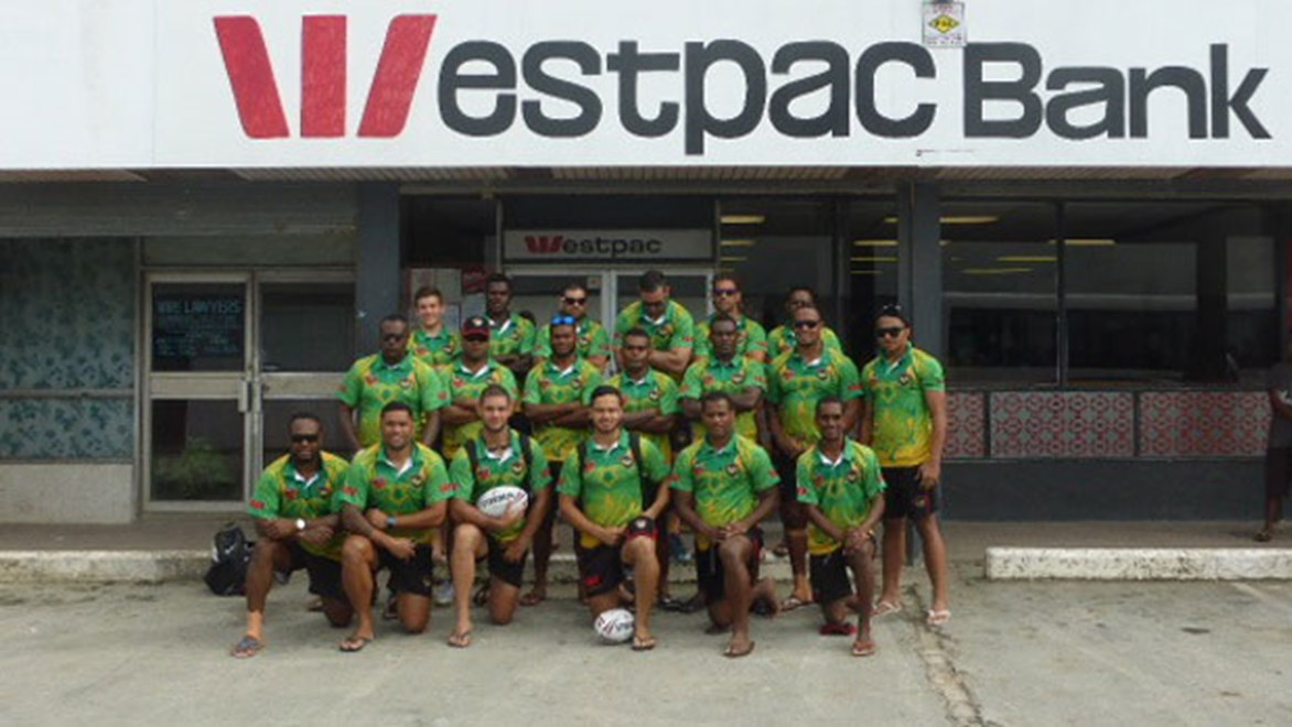 The Vanuatu team to take on the Phillippines poses for a picture out the front of a local Westpac branch.