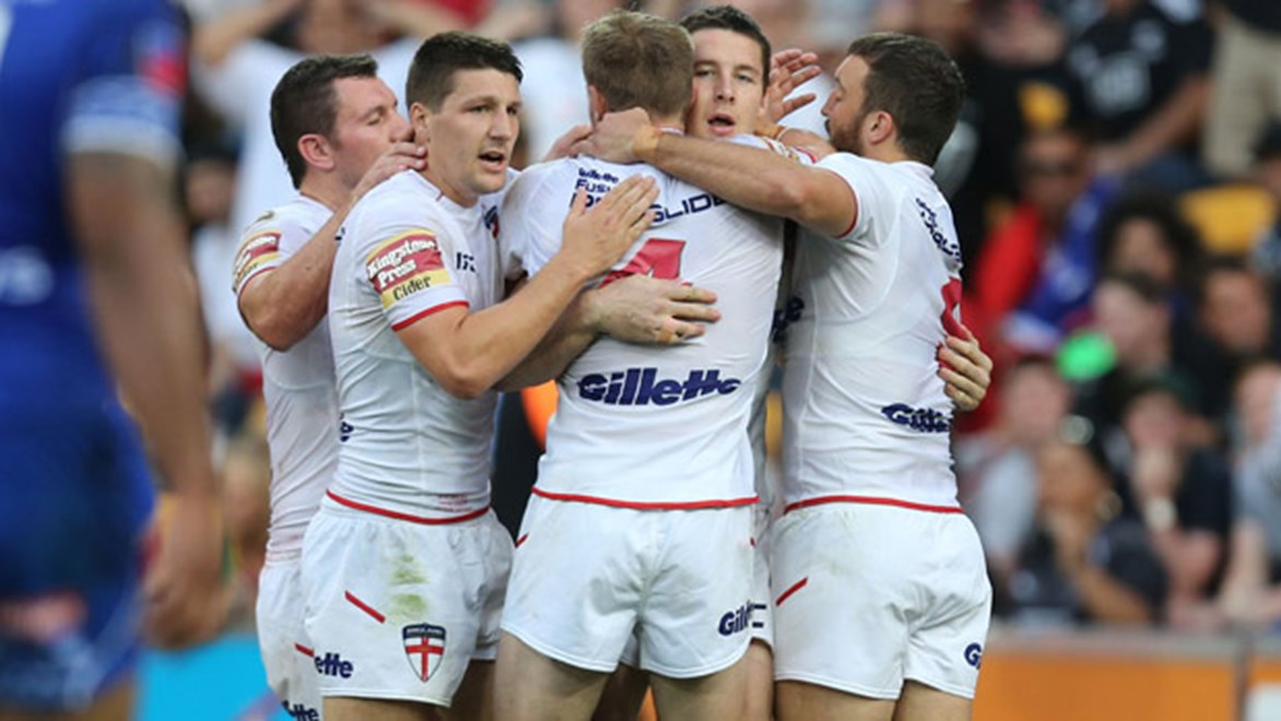 Gareth Widdop celebrates with teammates in England's opening Four Nations win over Samoa.