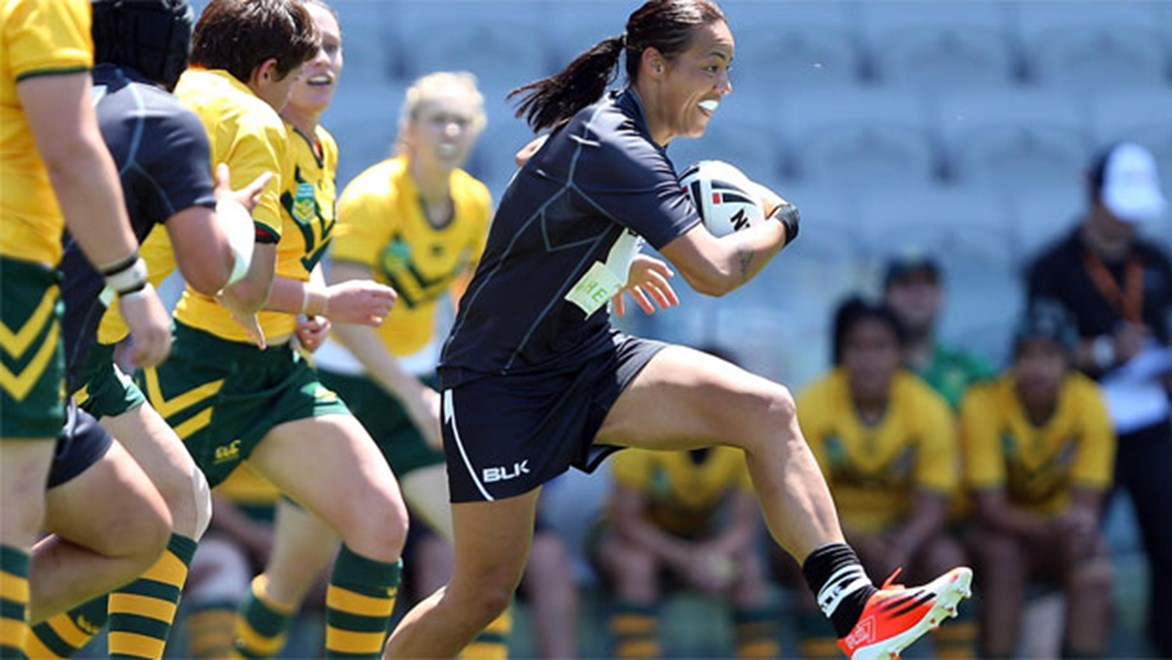 Sarina Fiso makes a break for the Kiwi Ferns against Australia's Jillaroos.