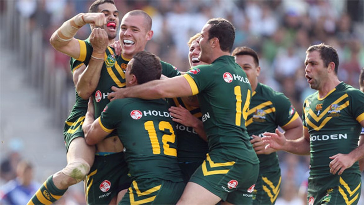 Barnstorming prop David Klemmer celebrates his first try for the Kangaroos.