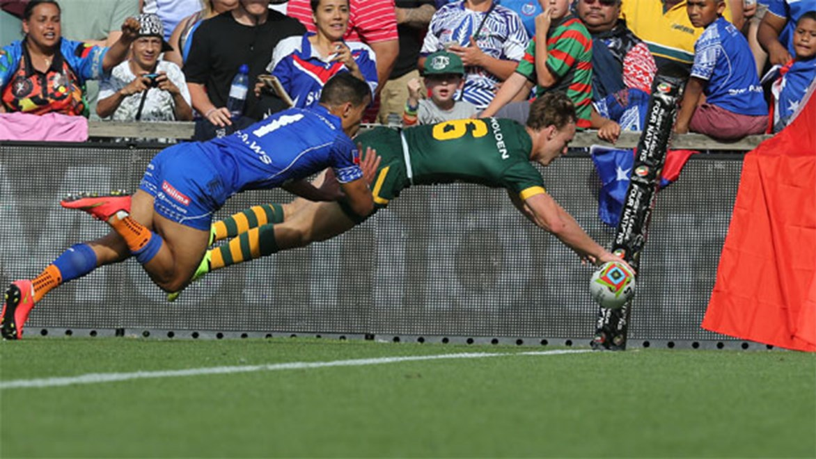 Daly Cherry-Evans dives over to score in the corner during Australia's Four Nations win over Samoa.