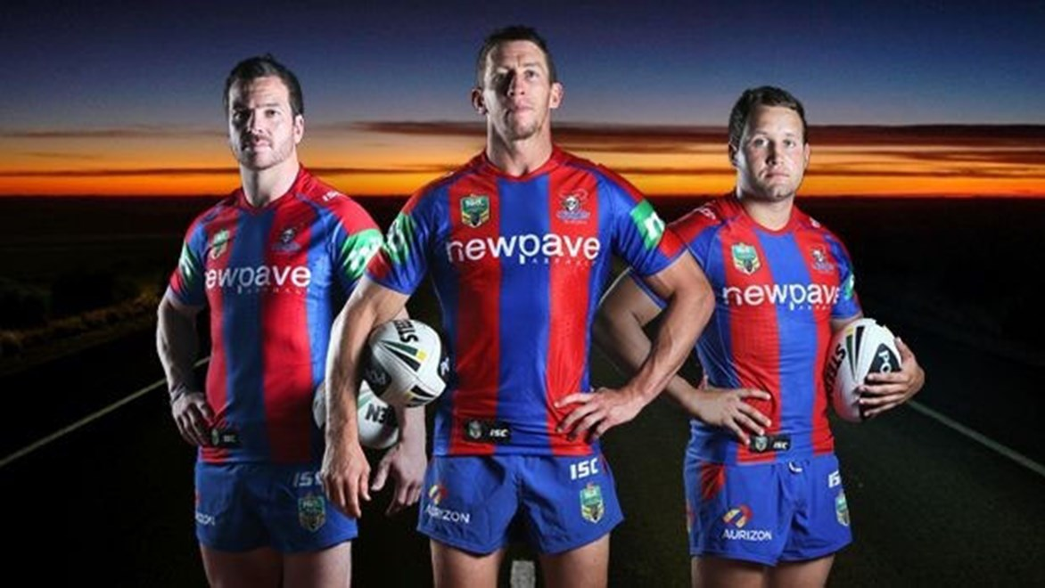 Jarrod Mullen, Kurt Gidley and Tyrone Roberts model Newcastle's new jersey and major sponsor.