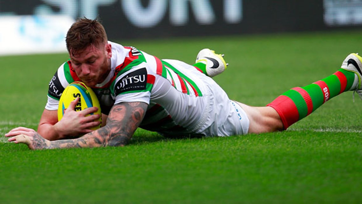 Chris McQueen scores for South Sydney in their Nines clash against Penrith.