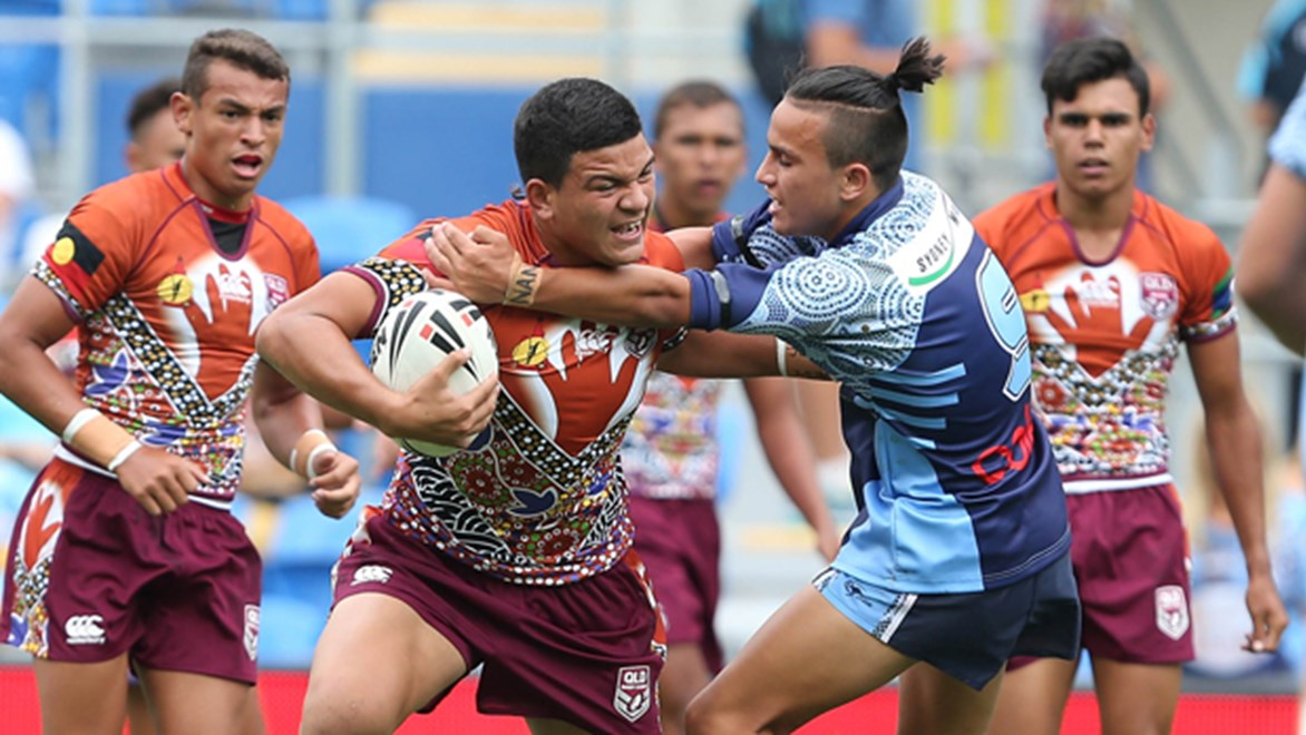 Queensland Indigenous Under-16s player David Fifita tries to fend Kyle McLean during the curtain-raiser to the 2015 All Stars main game.