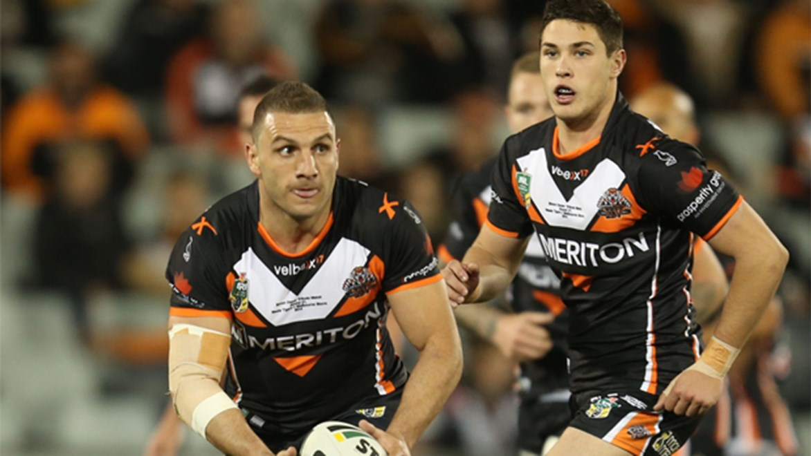 The old and the new... skipper Robbie Farah (left) and young gun Mitchell Moses (right) will be key men for the Wests Tigers in 2015.