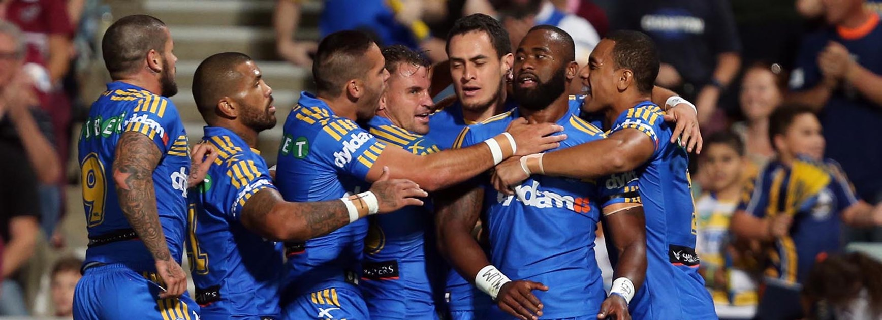 The Eels celebrate one of Semi Radradra's three tries against Manly in Round 1.