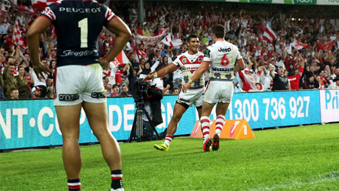 The Dragons celebrate Peter Mata'utia's try against the Roosters on Saturday.