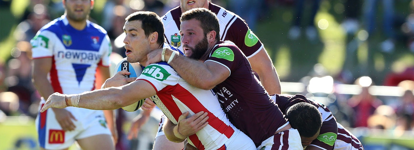 James McManus is tackled during the Knights clash with Manly at Brookvale Oval.