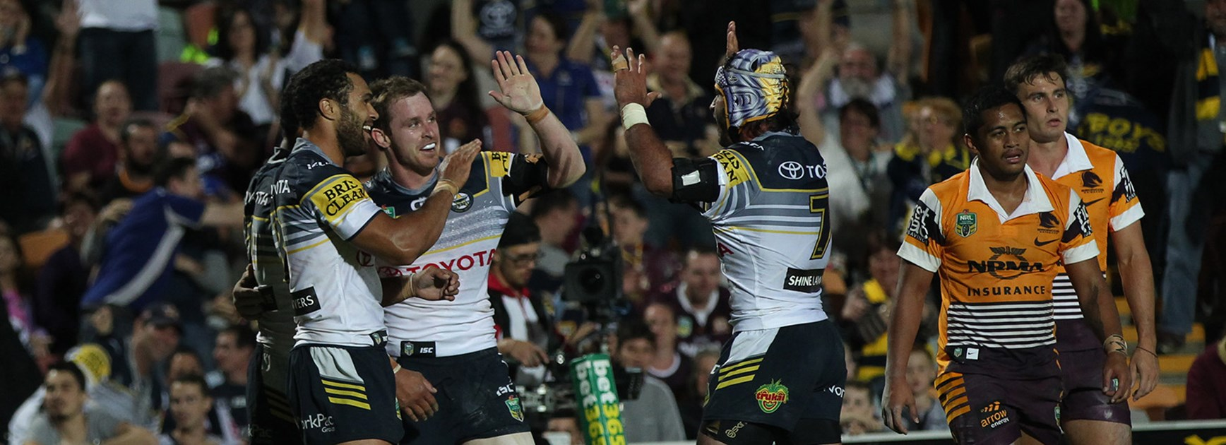 North Queensland celebrate another Michael Morgan try against the Broncos.