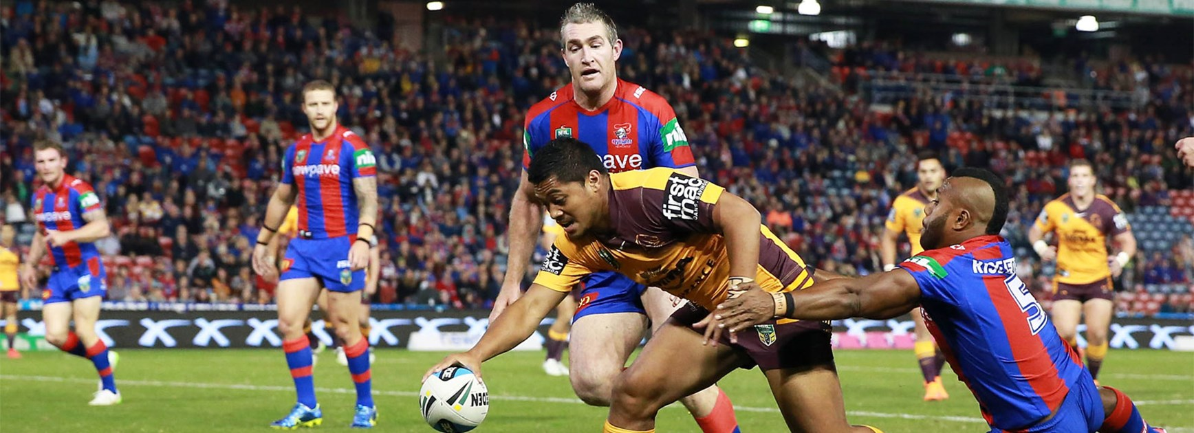 Anthony Milford scores the opening try for Brisbane against Newcastle on Monday night.