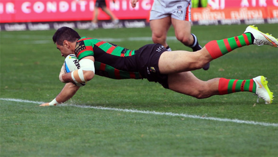 Bryson Goodwin dives over to score for South Sydney against the Warriors on Saturday.