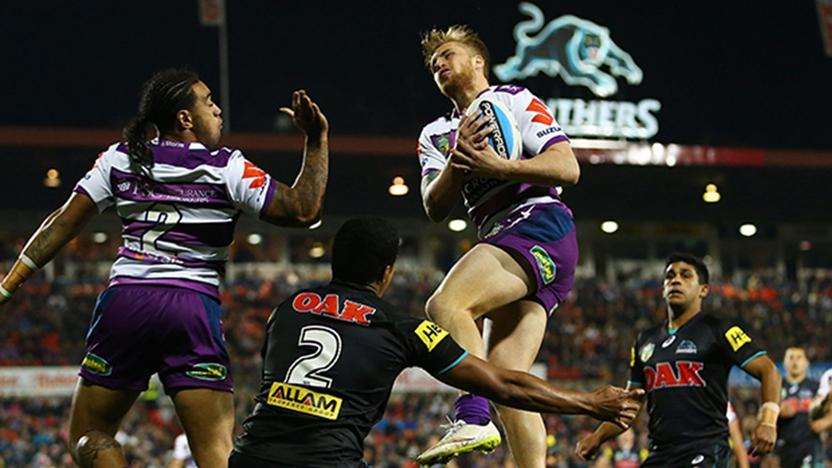 Storm fullback Cameron Munster flies high against the Panthers in their Round 13 Telstra Premiership match.
