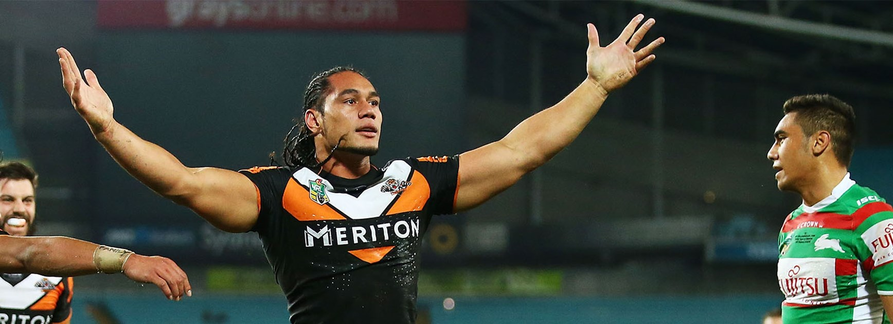 Martin Taupau celebrates his second try against the Rabbitohs at ANZ Stadium.