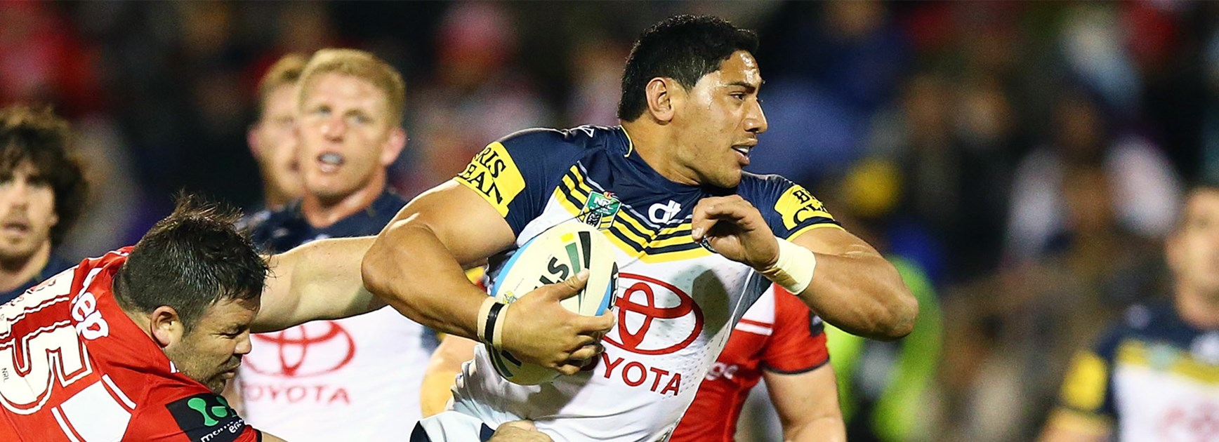 Jason Taumalolo busts through the Dragons' defensive line on Saturday night.
