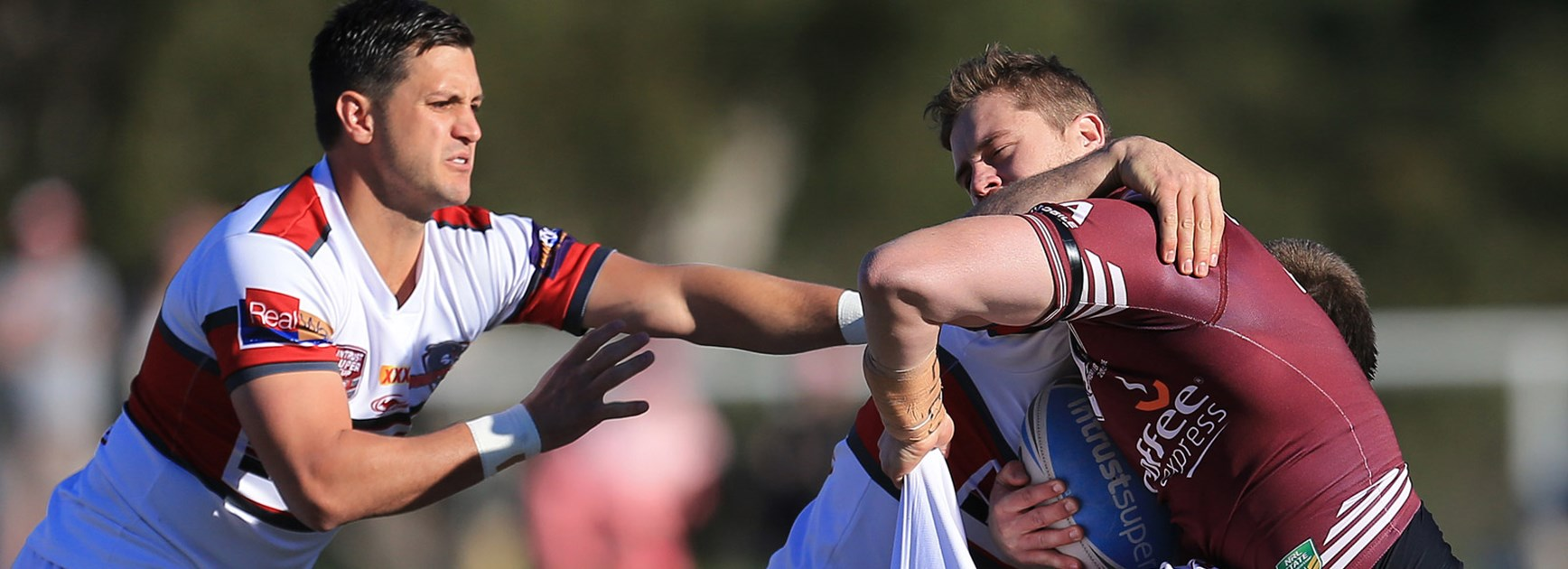 The Redcliffe defence swarms on Burleigh's Ayden Lee in their 64-6 drubbing of the Bears on Sunday.