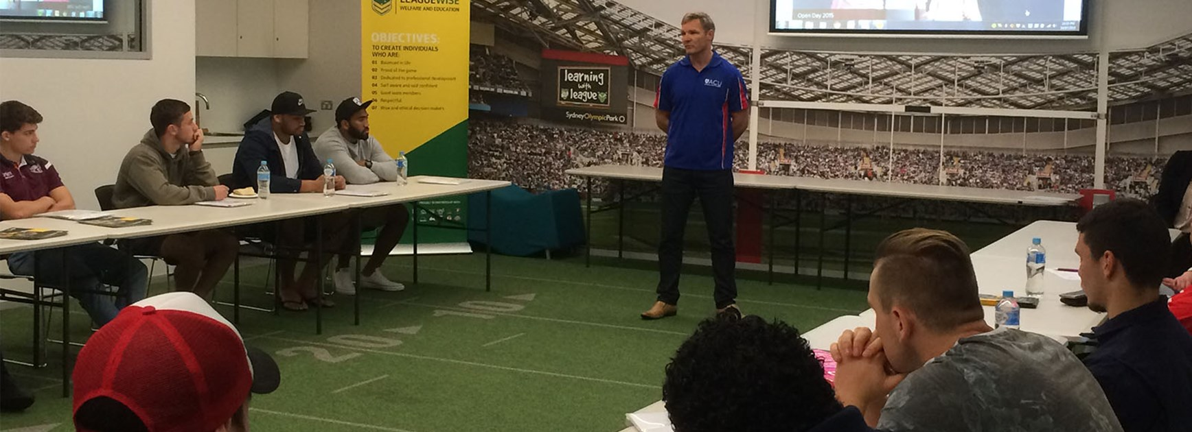 ACU and Broncos' Todd Lowrie addresses players during the NRL Graduates of Rugby League orientation day.